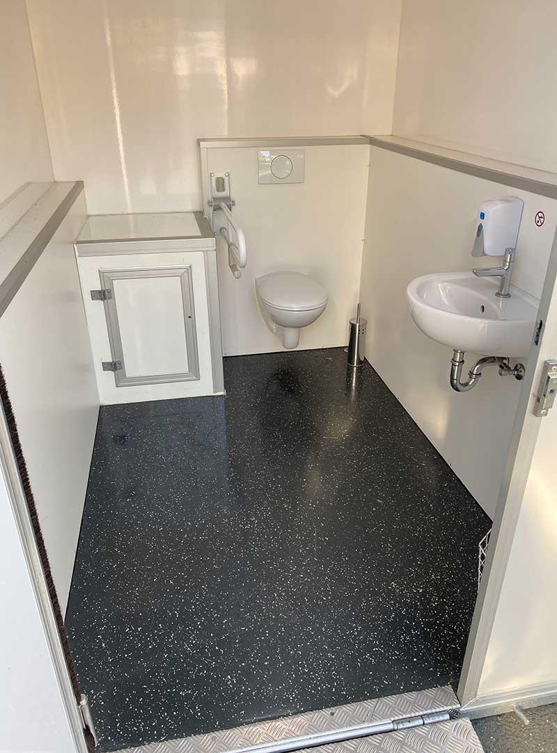Innenansicht des Toilettenwagens Variante Mini für Ihre Baustelle